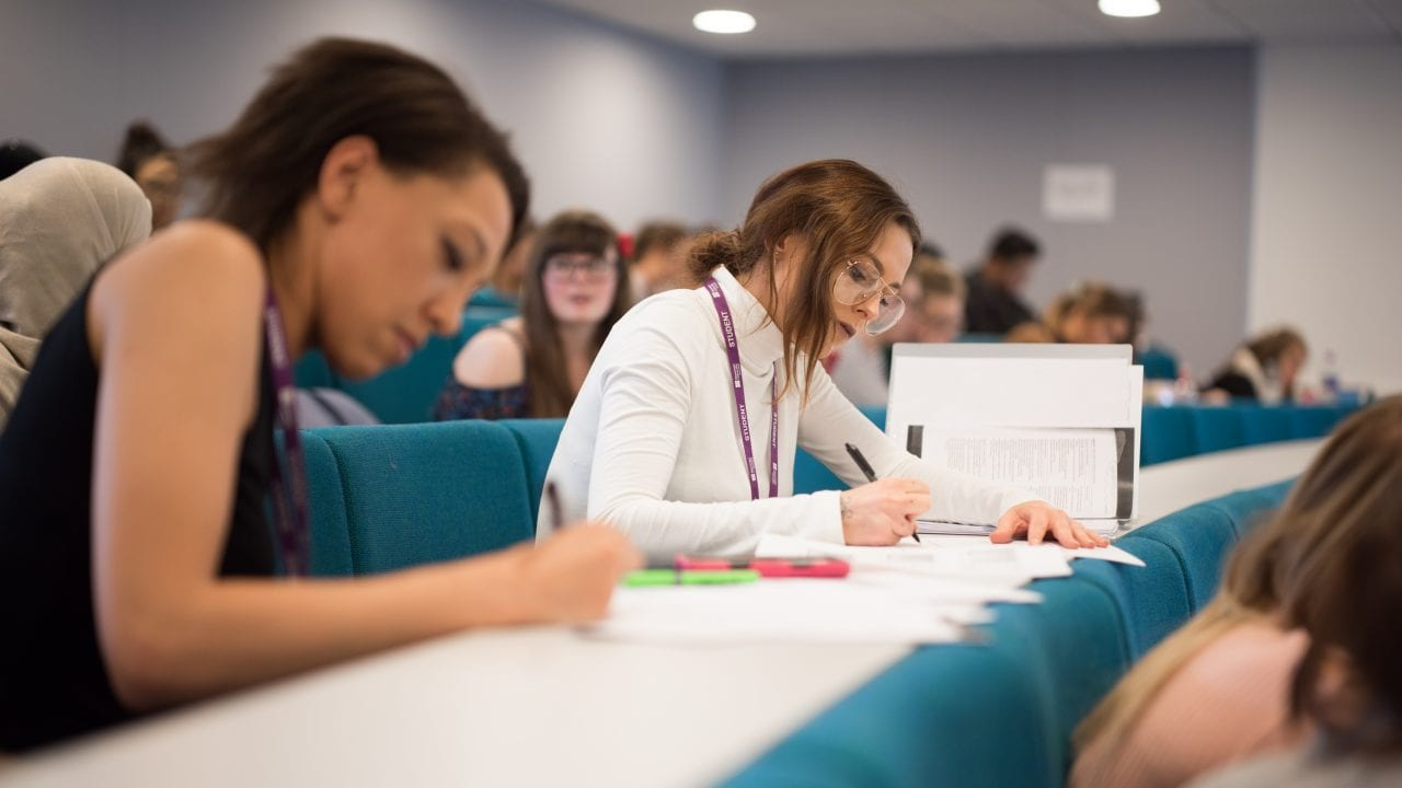 Lecture Theatre students writing