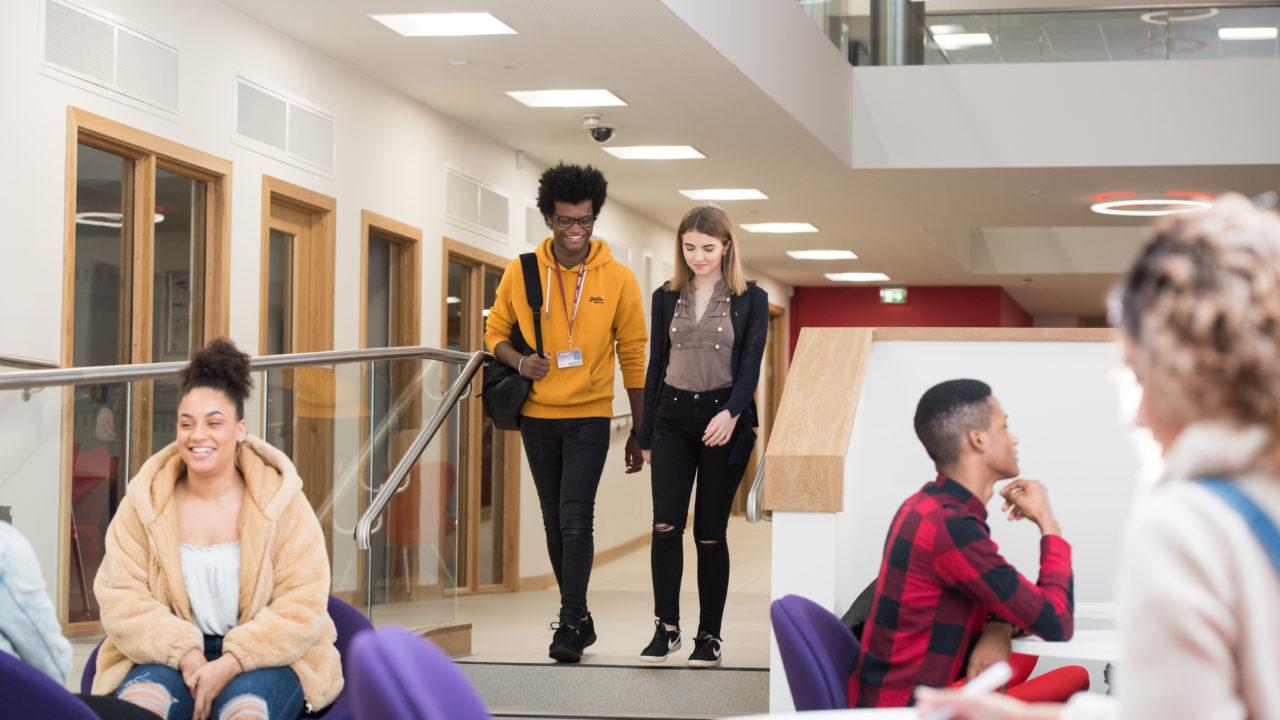 students walking in atrium