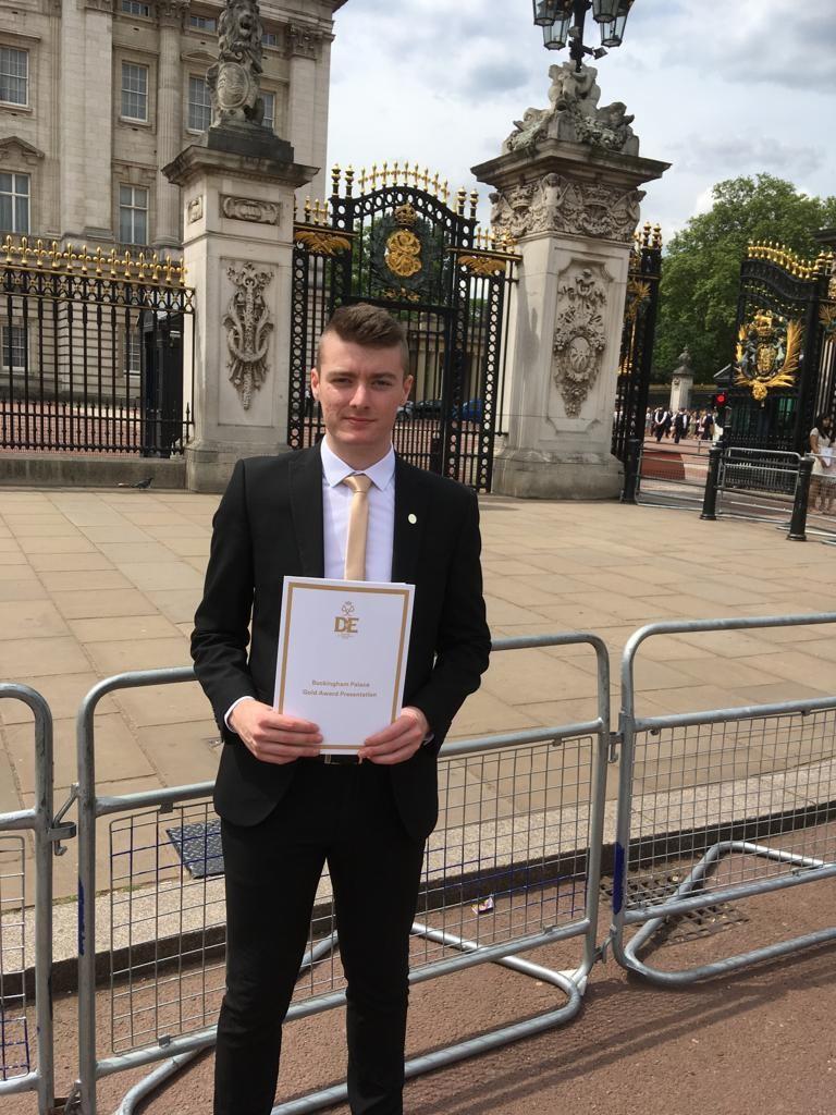 student Sam Hart collects Duke of Edinburgh award at Buckingham Palace