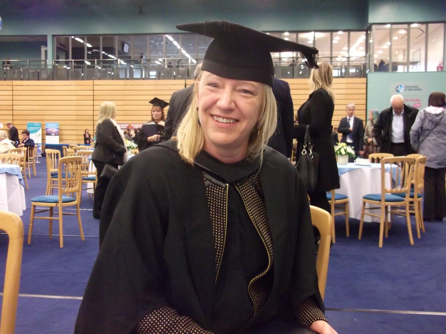 Newman graduate Yvonne at graduation ceremony
