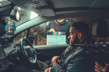 Jamaal filming for BBC short film sat in car