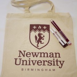 Newman branded merchandise including bag, pens and pencils