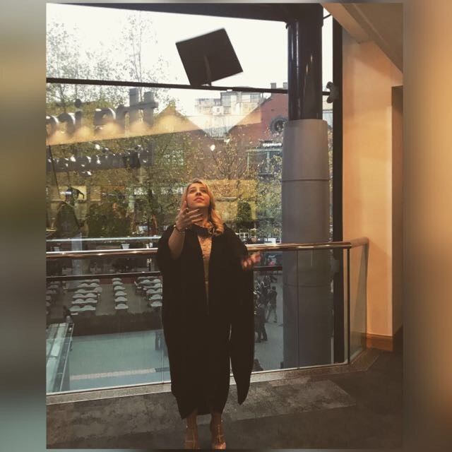 Early Years Alumni Christina Chatzichristodoulou throwing hat at graduation
