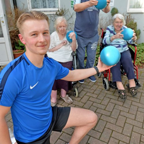 Sport student Joab Wheatley working at a care home with elderly residents helping them to keep fit