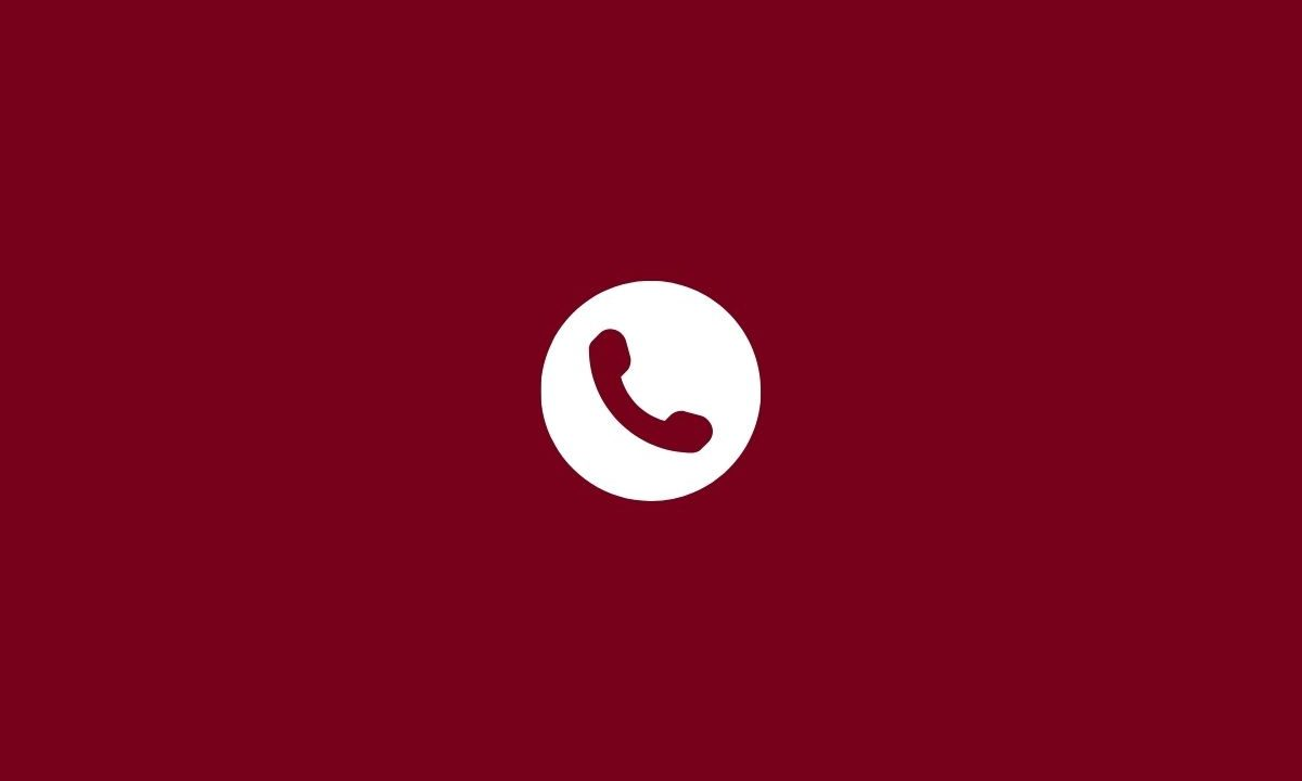 White telephone on red background