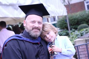 graduate with his son